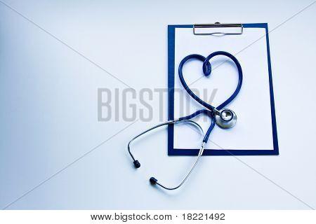 blank clipboard with modern stethoscope