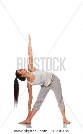 young woman doing exercise isolated on white background