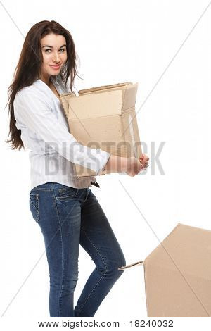 A young woman carrying a box