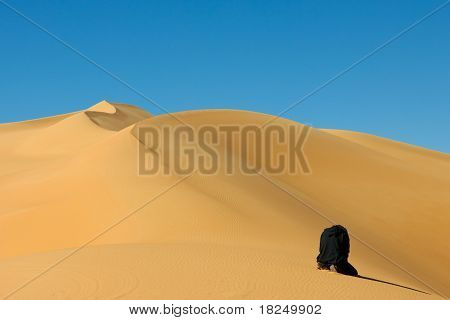 Man Praying In The Sahara Desert, Libya