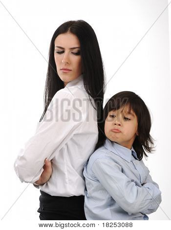 Mother and son standing back to back having relationship difficulties on white background