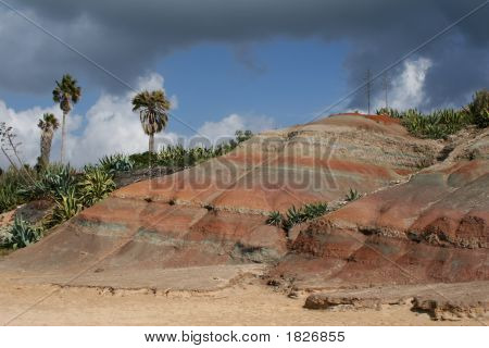 Coloured Cliffs With Dramatic Sky