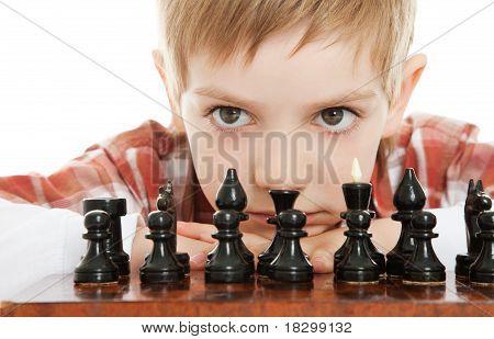 boy playing chess close up
