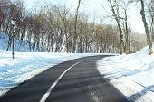 Winter road outside city poster