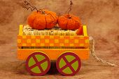 stock photo of hayride  - wooden cart with hay and pumpkins - JPG