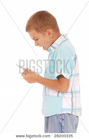 A Young Boy Is Furiously Screaming Into His Cell Phone.