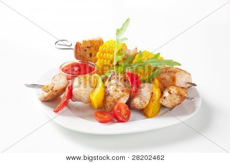 Meat and corn skewer with cherry tomatoes