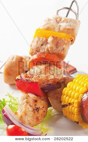 Skewer with meat and corn and vegetables