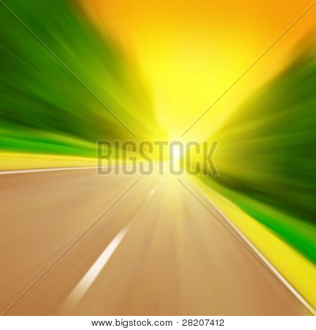 Road with motion blur at sunset.