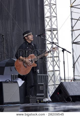CLARK, NJ - SEPTEMBER 12: Guitarist Nils Lofgren performs at the Union County Music Fest on September 12, 2010 in Clark, NJ. He is currently performing as part of the Nils Lofgren Acoustic Duo.