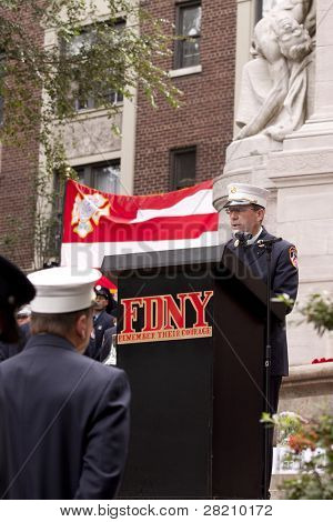 NEW YORK - SEPT 11, 2011: FDNY Chaplain Reverend Stephen Harding speaks at the 10TH anniversary remembrance ceremony at the Firefighters Memorial in Riverside Park on September 11, 2011 in New York.