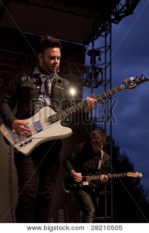 CLARK, NJ - SEPT 17: Bass guitar player Branden Campbell of the band Neon Trees performs at the Union County Music Fest on September 17, 2011 in Clark, NJ.