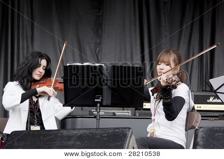 CLARK, NJ - SEPT 17: The string section for Nicole Atkins & The Black Sea perform at the Union County Music Fest on September 17, 2011 in Clark, NJ.