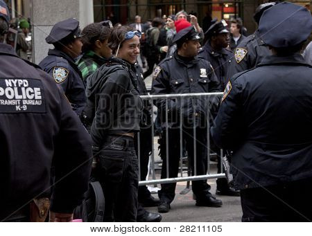 NEW YORK - NOV 17:  An unidentified woman smiles after being arrested at Broad & Beaver Streets on November 17, 2011 in New York City, NY.Today is the 2 month mark since the OWS movement began.