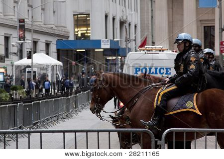 NEW YORK - NOV 17: Police officers on horseback temporarily at Broad Street and Exchange Place near the entrance to the NY Stock Exchange on the 'Day of Disruption' on November 17, 2011 in New York City, NY.