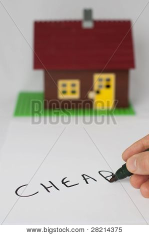 Text Cheap And House On Background.