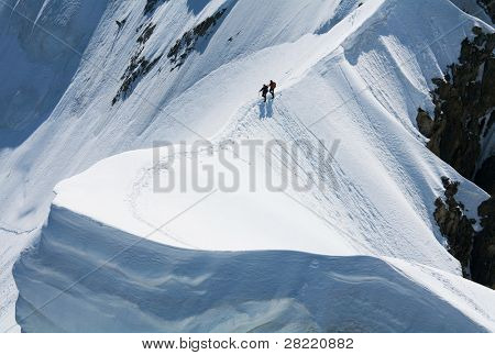 Team of two alpinists on Rochefort Ridge, France