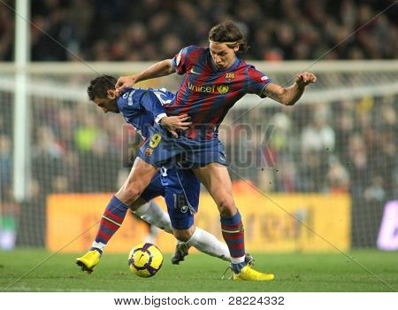 BARCELONA, SPAIN - DEC 12: Pareja (L) of Espanyol and Ibrahimovic (R) of Barcelona during Spanish league match between Barcelona and Espanyol at Camp Nou stadium December 12, 2009 in Barcelona, Spain.