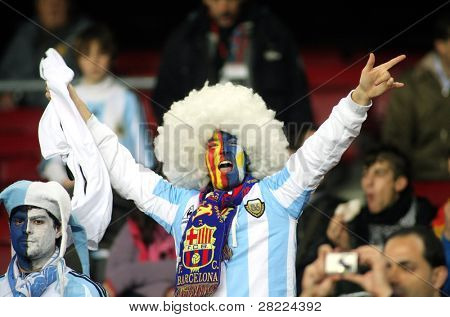 BARCELONA, SPAIN - DEC. 22: Argentinian supporter celebrate a goal during the friendly match between Catalonia vs Argentina at Camp Nou Stadium Dec. 22, 2009 in Barcelona.