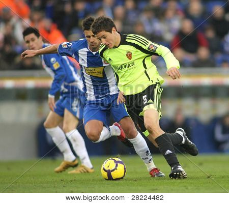 BARCELONA - JAN. 10: Marquez (L) of Espanyol with Ander Herrera (R) of Zaragoza during a Spanish League match Espanyol vs Zaragoza at the Estadi Cornella on January 10, 2010 in Barcelona, Spain