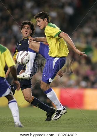 BARCELONA, SPAIN - MAY. 25: Brazilian player Edmilson (R) in action during the friendly match between Catalonia vs Brazil at Nou Camp Stadium on May 25, 2004 in Barcelona, Spain