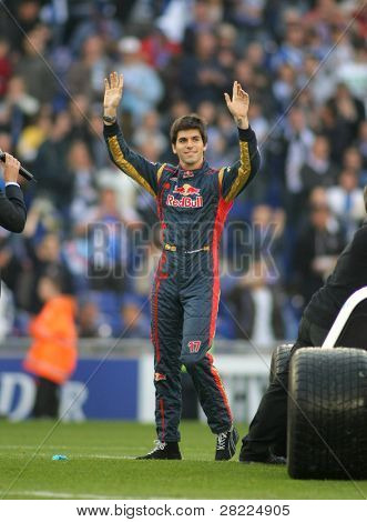 BARCELONA-APRIL 11: Formula1 driver Jaime Alguersuari waves to supporters before a Spanish League match between Espanyol vs Atletico Madrid at the Estadi Cornella on April 11, 2010 in Barcelona, Spain