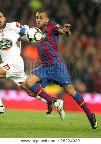 BARCELONA-APRIL 14: Dani Alves of Barcelona in action during a Spanish League match between FC Barcelona and RC Deportivo at the Nou Camp Stadium on April 14, 2010 in Barcelona, Spain