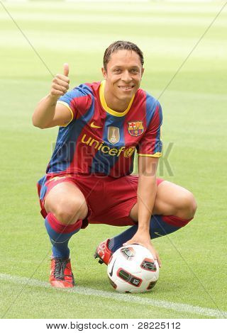 BARCELONA, SPAIN - JULY 19: Futbol Club Barcelona's new Brazilian defender Adriano Correia during his official presentation with the Catalan giants in Barcelona on July 19, 2010 in Barcelona.