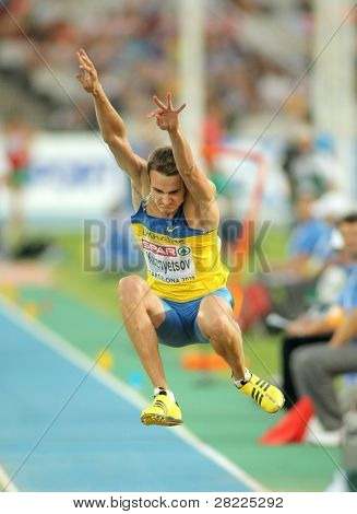 BARCELONA, SPAIN - JULY 27: Viktor Kuznyetsov of Ukraine on the men triple jump final during the 20th European Athletics Championships at the Olympic Stadium on July 27, 2010 in Barcelona, Spain