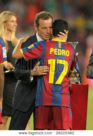 BARCELONA - AUGUST 21: President of FC Barcelona Sandro Rosell with Pedro after the supercup match between Barcelona vs Sevilla at the New Camp Stadium in Barcelona on August 21, 2010