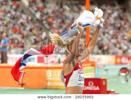 BARCELONA, SPAIN - JULY 30: Yuliya Zarudneva of Russia celebrates gold on 3000m steeplechase during the 20th European Athletics Championships at the Olympic Std. on July 30, 2010 in Barcelona, Spain