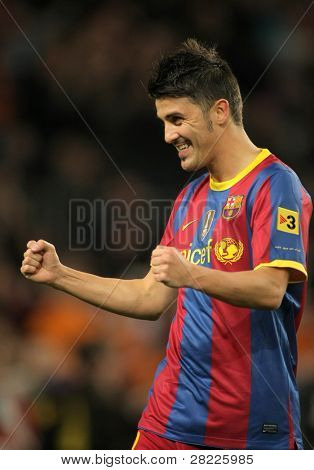 BARCELONA - OCT 30: David Villa of FC Barcelona celebrates goal during spanish league match between FC Barcelona and Sevilla FC at Nou Camp Stadium on October 30, 2010 in Barcelona, Spain