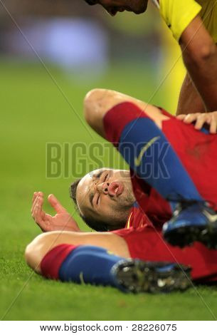 BARCELONA - NOV 13: Iniesta of FC Barcelona injured during spanish league match between FC Barcelona and Villarreal CF at Nou Camp Stadium on November 13, 2010 in Barcelona, Spain
