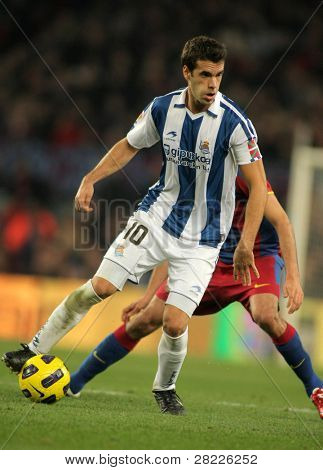 BARCELONA - DEC 12: Xabier Prieto of Real Sociedad in action during a Spanish League match between FC Barcelona and Real Sociedad at the Nou Camp Stadium on December 12, 2010 in Barcelona, Spain