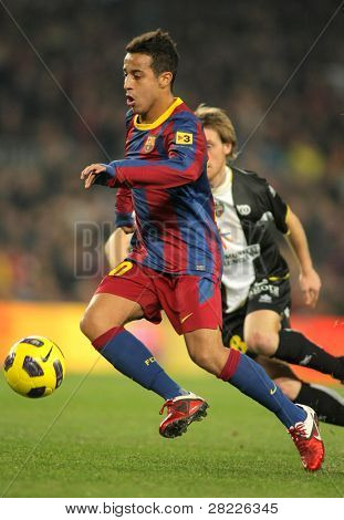 BARCELONA - JAN 2: Thiago Alcantara of Barcelona during a Spanish League match between FC Barcelona and UD Levante at the Nou Camp Stadium on January 2, 2011 in Barcelona, Spain