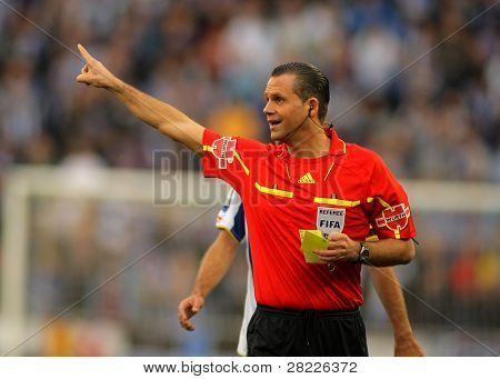 BARCELONA - JAN 9: Referee Muniz Fernnadez during a Spanish League match between Espanyol and Real Zaragoza at the Estadi Cornella on January 9, 2011 in Barcelona, Spain