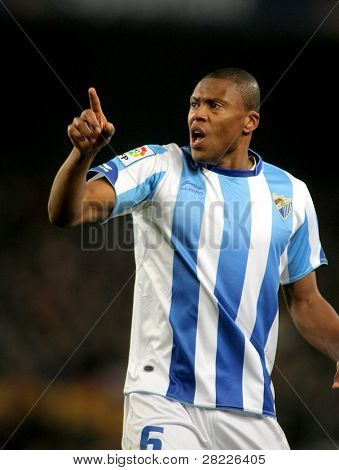 BARCELONA - JAN 16: Julio Baptista of Malaga during the spanish league match between FC Barcelona and Malaga CF at the Nou Camp Stadium on January 16, 2011 in Barcelona, Spain