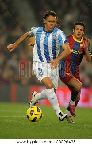 BARCELONA - JAN 16: Martin Demichelis of Malaga during the match between FC Barcelona and Malaga CF at the Nou Camp Stadium on January 16, 2011 in Barcelona, Spain