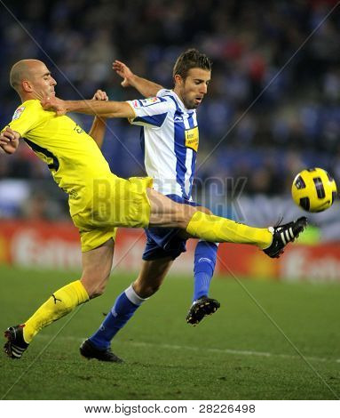 BARCELONA - JAN 30: Borja Valero of Villareal(L) with Luis Garcia(R) of Espanyol compete during a match between Espanyol and Villareal at the Estadi Cornella on January 30, 2011 in Barcelona, Spain