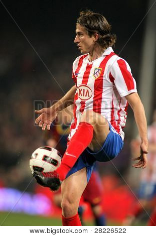 BARCELONA - FEB 5: Filipe Luis Kasmirski of Atletico Madrid during the match between FC Barcelona and Atletico Madrid at the Nou Camp Stadium on February 5, 2011 in Barcelona, Spain