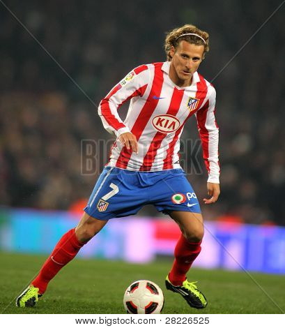 BARCELONA - FEB 5: Diego Forlan of Atletico Madrid during the match between FC Barcelona and Atletico Madrid at the Nou Camp Stadium on February 5, 2011 in Barcelona, Spain