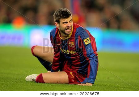BARCELONA - MARCH 5: Gerard Pique of Barcelona during the match between FC Barcelona and Real Zaragoza at the Nou Camp Stadium on March 5, 2011 in Barcelona, Spain