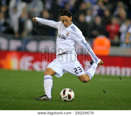 BARCELONA - FEB 13: Mesut Ozil of Real Madrid during a spanish league match between Espanyol and Real Madrid at the Estadi Cornella on February 13, 2011 in Barcelona, Spain