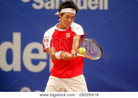 BARCELONA - APRIL 19: Japanese Kei Nishikori in action during the first round match of the Barcelona tennis tournament Conde de Godo on April 19, 2011 in Barcelona.
