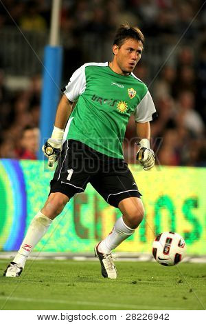 BARCELONA - APRIL 19: Diego Alves of Almeria in action during the match between FC Barcelona and UD Almeria at the Nou Camp Stadium on April 9, 2011 in Barcelona, Spain