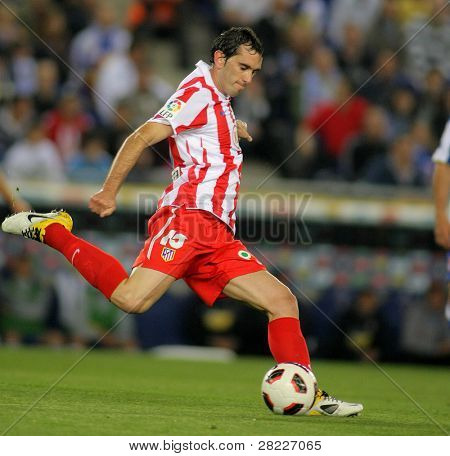 BARCELONA - APRIL 17: Diego Godin of Atletico Madrid in action during a Spanish League match between Espanyol and Atletico Madrid at the Estadi Cornella on April 17, 2011 in Barcelona, Spain
