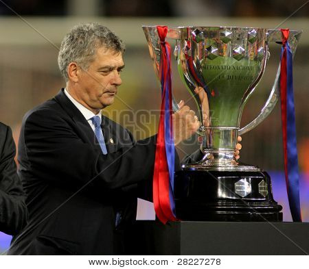 BARCELONA - MAY 15: Angel Maria Villar President of Spanish Football Federation with the spanish league trophy during a the winners celebration at Nou Camp Stadium in Barcelona, Spain May 15, 2011