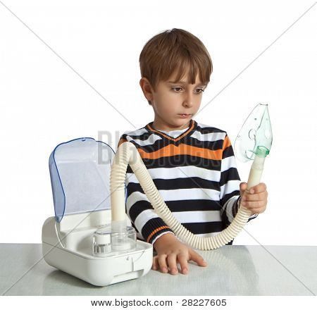 little boy makes inhalation with nebuliser