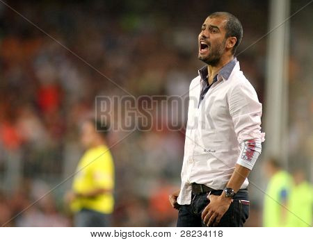 BARCELONA, SPAIN - AUG. 19: Barcelona's coach Josep Guardiola reacts during the match 44th Trophy Joan Gamper between FC Barcelona and Manchester City at Nou Camp Stadium in Barcelona, Spain. August 19, 2009.