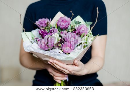 poster of Florist Woman Holding A Beautiful Colourful Blossoming Flower Bouquet Of Fresh White Pink Tulips, Ra